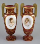 A pair of Bohemian gilt decorated ruby glass two handled vases, late 19th century, height 32cm
