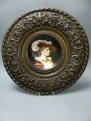 A French porcelain plaque in metal frame, overall diameter 40cm