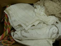 A quantity of table linen and a pair of rope tiebacks