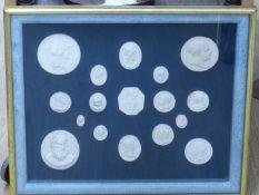 A framed set of Italian plaster cameos