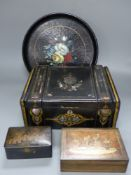 A mother of pearl inlaid lacquer writing box, two smaller boxes and a circular tray