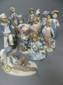 Fourteen Lladro figures of children