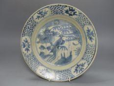 A Chinese Swatow ware blue and white dish, early 17th century, diameter 26cm