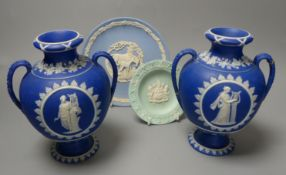 Four pieces of Wedgwood jasper wares including a pair of Victorian blue jasper vases, height 18.5cm,