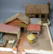 A model farmhouse and a small quantity of lead figures