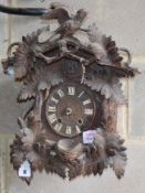 A late 19th century Black Forest cuckoo clock, W.33cm, D. 14cm, H.42cmCONDITION: Has movement and