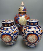 A Japanese Imari vase and cover, by Fukugawa, early 20th century and a similar pair of jars and