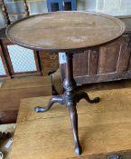 A George III mahogany birdcage tilt top tripod table, diameter 62cm, height 72cm
