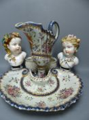 A pair of French porcelain busts 'Automne' and 'Printemps', a Samson ewer and basin in the Chinese