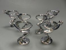 A post war chrome set of six figural egg holders, height 9cm