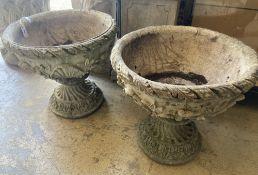 A pair of reconstituted garden stone planters, 54cm diameter, height 51cm