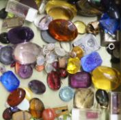 A quantity of mainly assorted loose cut and cabochon gemstones including amethyst, citrine, opal,