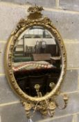 A Victorian oval giltwood and gesso girandole, width 50cm, height 88cm