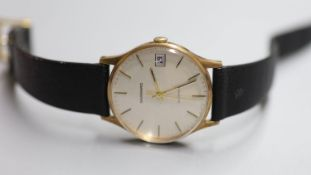 A gentleman's 1980's yellow metal automatic wrist watch, retailed by Garrard, with case back