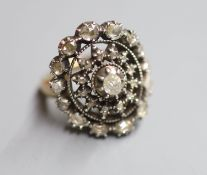 An antique yellow and white metal, rose cut diamond set dress ring, size P/Q, gross 15.6 grams.