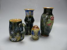 Four pieces of Royal Doulton stoneware including two vases, a mug and a pepperette, tallest 16cm