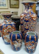Four Japanese Imari vases, Meiji period, together with a carved hardwood and marble inset stand,