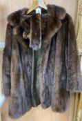 A brown mink fur coat, hat and ties