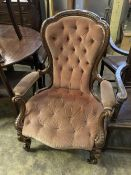 A Victorian carved walnut upholstered spoon back armchair, width 75cm, depth 70cm, height 102cm