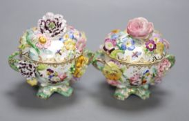 A mid 19th century Coalport pair of floral encrusted two handled cups and covers