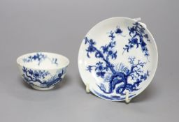 An 18th century Worcester prunus root pattern tea bowl and saucer, diameter 11.5cm, early large