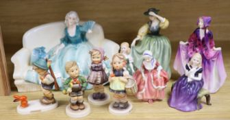 A collection of Hummel figures and Doulton ladies and a Katzhutte figure on a settee