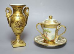 A 19th century Paris porcelain two handled chocolate cup, cover and stand painted with two