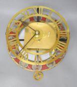 A brass skeleton wall timepiece stamped Bell Bros. Bristol