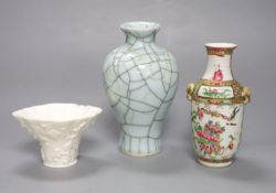 A Chinese white glazed libation cup, a similar famille rose vase and a crackle glaze vase, tallest
