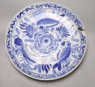 A Chinese blue and white 'fish' dish, diameter 36cm (a.f.)