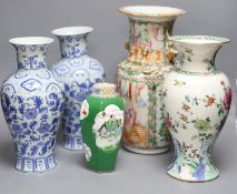 A Chinese famille rose Canton vase, a pair of blue and white vases and two others, tallest 35.