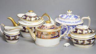 Three various porcelain teapots, a cream jug and a sucrier
