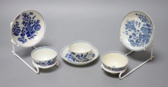 Three 18th century Worcester tea bowls and saucers, two printed with Three Flowers and one printed