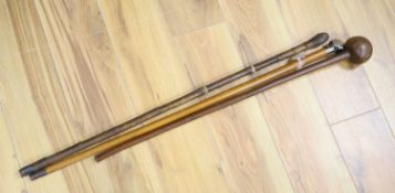 A sword stick, a knobkerrie and an agate mounted cane