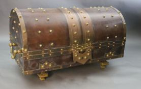 An ormolu and brass mounted leather dome top coffer, with bold studded decoration over a brown