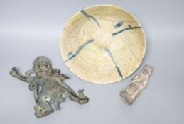 An Egyptian style stone carving, a Tibetan bronze of a deity and a Persian bowl, diameter 19cm