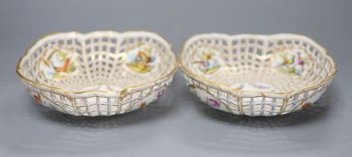 A pair of fine Continental pierced baskets, the panels painted with birds or flowers inside and out,