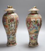 A pair of 19th century Chinese famille rose vases and associated covers, height excl. cover 28cm (
