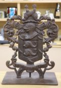 A cast iron armorial crest, height 70cm