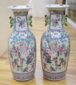 A pair of late 19th century Chinese large famille rose vases, height 61cm, one cracked