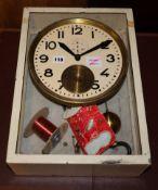 A Brillie cream painted zinc and white marble clocking on/clocking off pendulum clock, H.43.5cm.,