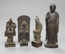 Two Chinese bronze Buddha, a bronze of a deity and a carved wood Buddha, tallest 11cm