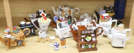 A collection of thirteen Portmeirion and Cardew novelty teapots, including dresser, sewing machine
