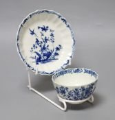 An 18th century Worcester tea bowl and saucer painted with the Hollow Rock Lily pattern, crescent