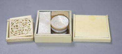 A 19th century ivory box containing a collection of fourteen Chinese carved mother-of-pearl gaming