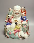 A large Chinese famille rose figure of Budai and children, mid 20th century, height 28cmCONDITION: