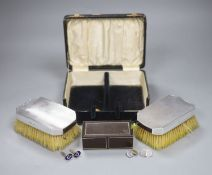 A pair of silver and enamel Masonic cufflinks, two other pairs and cased silver backed brushes.