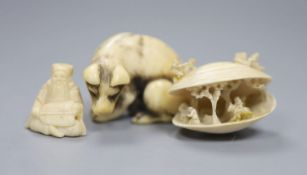 An 18th/19th century Japanese ivory netsuke, in the form of a seated wolf, signed to underside, 3.