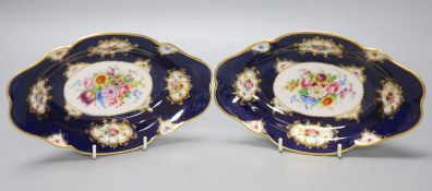 A pair of Royal Worcester blue ground floral painted dishes by E Phillips, signed date code for