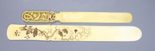 A Meiji period Japanese shibayama style ivory page turner, decorated with birds, flowers and